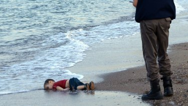 The lifeless body of Aylan Kurdi lies on a Turkish beach.
