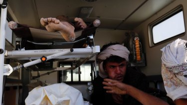Bodies of victims of a Saudi-led coalition airstrike are loaded into an ambulance.