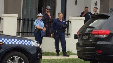 Police outside the house in Lockwood Street, Merrylands.