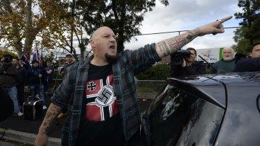 Glenn Anderson shouts at a Muslim woman at an anti-Islam rally in May 2015.