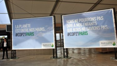 """Boards reading """"The planet is in our hands"""" and """"We cannot say to our children that we did not know"""" are pictured on the site of the UN Climate Conference scheduled for Paris at the end of the month."""