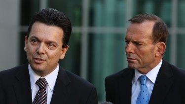 Independent Senator Nick Xenophon and Prime Minister Tony Abbott.