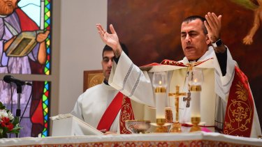 Iraqi Chaldean Archbishop Amel Nona holds Christmas Mass at St Mary's Assumption Church in Fairfield, Sydney.