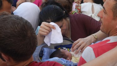 Baby Malia is eight days old. Her mother fled the ruins of Kobane, Syria.