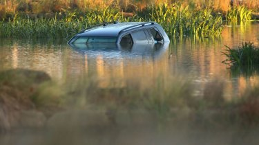 Akon Guode's car in the lake where three of her children died in April 2015.