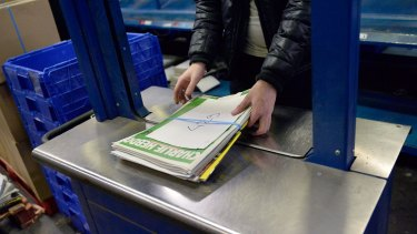 A worker prepares the new edition of <i>Charlie Hebdo</i> for delivery in Marne-la-Vallee, France.  Five million copies of the controversial magazine have been printed in the wake of last week's terrorist attacks.
