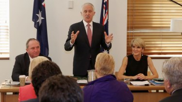 Prime Minister Malcolm Turnbull, pictured addressing the joint party room in November, will attempt to find a middle way.