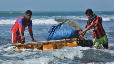 Rohingya fishermen pull a raft made of empty plastic containers along the coastline of the Bay of Bengal in Maungdaw, western Rakhine state after fishing boats were outlawed s part of a counter-insurgency campaign.