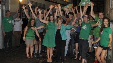New Greens Member for Melbourne, Ellen Sandell, celebrates with supporters.