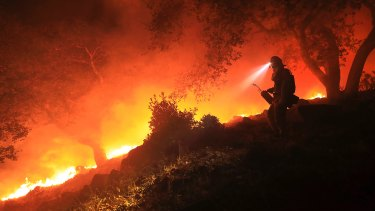 A firefighter monitors a flare up in Sonoma, California.