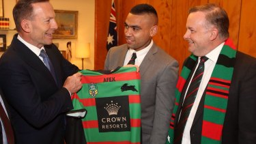 Politics mixing with sport: The then prime minister Tony Abbott was presented with a South Sydney jersey alongside ALP shadow minister and Bunnies tragic Anthony Albanese in 2014.