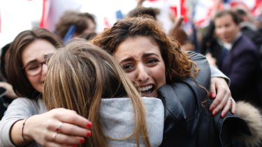 Supporters of Macron react outside the Louvre museum in Paris.