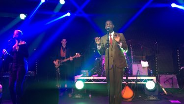 Leon Bridges performing with his band in Melbourne.