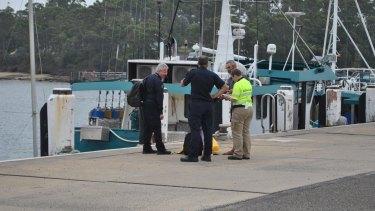 Alan Langdon speaks with Australian Border Force officials at Ulladulla Harbour.