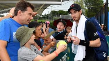 Fan favourite: Andy Murray talks to supporters after his practice session at the Brisbane International.