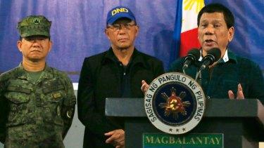 Philippine President Rodrigo Duterte, right, addresses the 2nd Mechanized Brigade  on Friday near Iligan city in the southern Philippines.