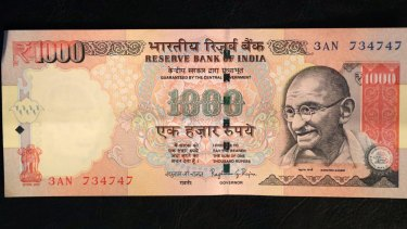 A 1000 rupee Indian currency note which is being withdrawn from midnight on Wednesday.