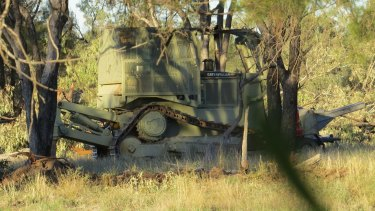 A camouflaged bulldozer used to clear land near Walgett.