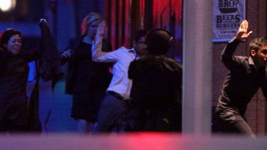 Hostages flee after police raided the Lindt cafe.