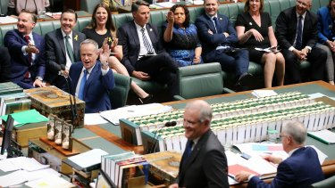 Opposition Leader Bill Shorten and his frontbench react to Treasurer Scott Morrison and Prime Minister Malcolm Turnbull during question time.