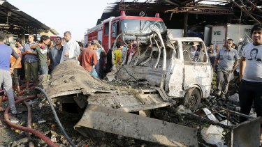 A destroyed vehicle is seen at the site of a truck bomb attack.