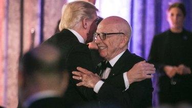 Rupert Murdoch embraces President Trump.