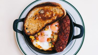 Spanish baked egg, 1904 baked beans, sausage, salsa and toast at Bodega 1904.