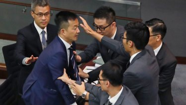 Lawmaker Raymond Chan Chi-chuen tries to break through the security guards during the election of president of the Legislative Council in Hong Kong.