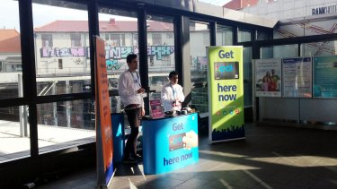 An Opal pop-up kiosk at Newtown station, where rail patronage has surged 26 per cent in the past two years.