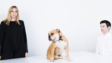 David Caon with his wife and studio director Jeramie Hotz, and the couple's bulldog, Bagel.