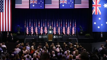 Waving the flags: The audience repeatedly applauded President Obama.