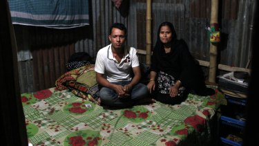 Forhad Mia and his wife Raifa who worked for $65 a month in a factory used by Kmart in 2013. They said their salaries were too low to live on.
