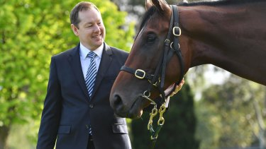 Adam Rytenskild, Tabcorp's chief operating officer of wagering, with Justice Faith.