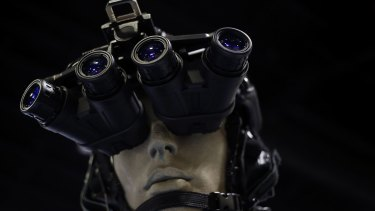 Traditional night-vision goggles are displayed on a at a military conference in Florida.