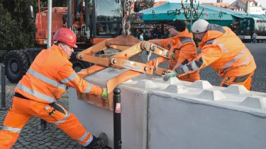 Workers set concrete barriers at the Christmas market in Erfurt, central Germany.