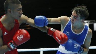 New era: Michael Conlan of Northern Ireland (R) fights with a gash over his left eye against Matthew Martin from Nauru.