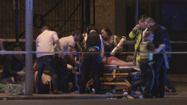 People receive medical attention in Thrale Street near London Bridge.