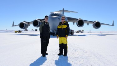 Polar milestone:  Air Commodore Richard Lennon (left) and Australian Antarctic Division director Nick Gales mark the arrival of the RAAF C-17 Globemaster in Antarctica.
