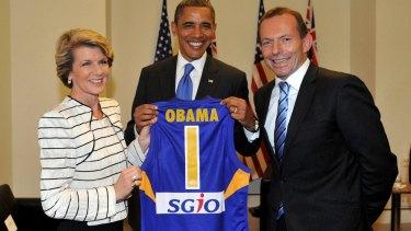 Julie Bishop presents Barack Obama with an Eagles jumper.