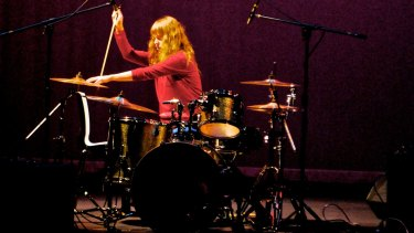 Drummer Holly Harrison performs in Sydney composer John Encarnacao's trio Espadrille.