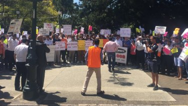 """Taxi drivers at a 2015 protest against """"illegal taxi services"""" outside Parliament in Brisbane."""