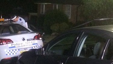 Police in front of the Bexley home where a woman was stabbed to death and her daughter was injured.