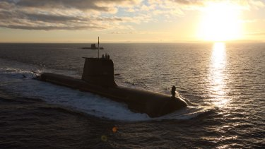The author of a major shipbuilding report commissioned by the Abbott government were specifically asked to leave out of its calculation the cost of building submarines.