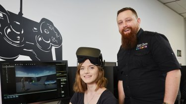 SAE bachelor of games development student  Victoria McAlary and lecturer Geoff Hill.