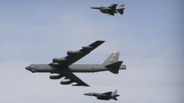 A US Air Force B-52 bomber flies over Osan Air Base in Pyeongtaek, South Korea.