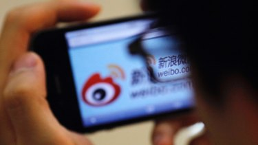 A user utilises a smartphone to visit the Sina Weibo microblogging site in China.