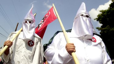 Members of the Ku Klux Klan are on the march.