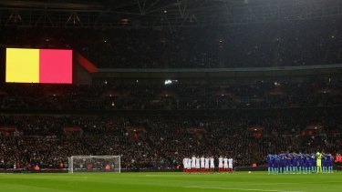 England and Netherlands players observe a minute of silence for the victims of the Brussels terror attacks at Wembley Stadium on Tuesday.