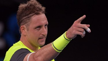 Sympathies questioned: Tennys Sandgren celebrates his round-of-16 win over Dominic Thiem of Austria.