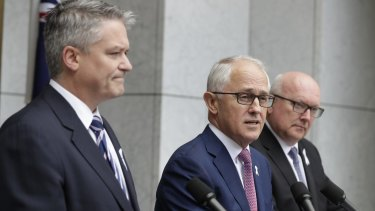 Prime Minister Malcolm Turnbull, flanked by Finance Minister Mathias Cormann and Attorney-General George Brandis, announces the proposed laws on Tuesday.